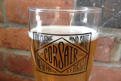 A pint glass of beer at Corsair, apartments for rent in New Haven