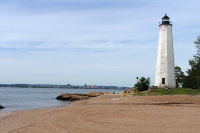 Five Mile Point Lighthouse is the namesake landmark of Lighthouse Point, New Haven's city-owned beach. It's a quick trip from Corsair, where you can find a new apartment in New Haven. Photo by Charles Barneby, public domain.