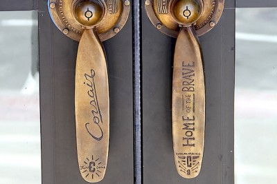 In this detail of the finished door handles installed at Corsair, you can see inscriptions inspired by history of the site where the new apartments in New Haven now stand.